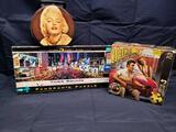 Times Square and Legends of Silver screen puzzles. Marilyn Monroe metal purse.