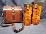 Leather case and 2 Wine or tall item storage containers.