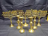 5 Brass Menorahsand 4 Brass Candlesticks.
