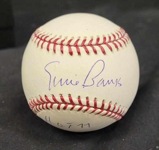 Autographed baseball saying Ernie Banks