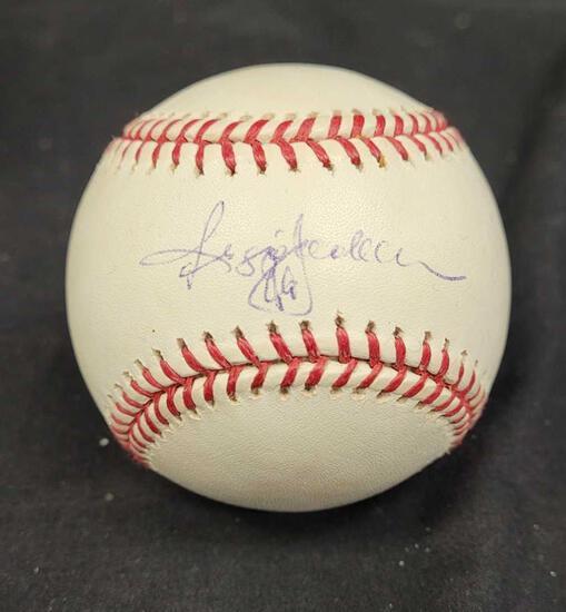 Autographed baseball says Reggie Jackson
