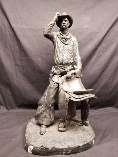Statue says 1972 Michael Garman. Cowboy with saddle