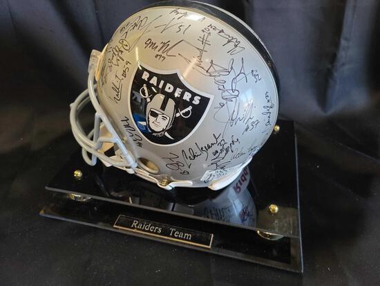 Helmet plaque says Raiders Team signed Hof