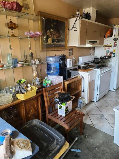 Entire Dining Room working side be side lizard tanks collectibles some equipment statues etc.