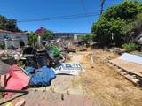 Backyard- Rusty Gold - Fencing lumber beams ladders trashcans rototiller pallet racking