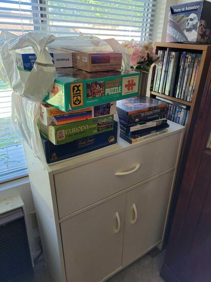 Small stoarage cabinet w drawer and 2 doors. Dvds games