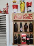 Vintage Coca Cola Bottles Display and Memorabilia