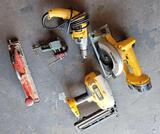 Crate full of power tools DeWalt cordless skill saw, power drill small vice air Sander, nail gun