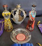 Crown Royal bags, metal crown, Madonna Inn ashtray, Mexican glass figures.