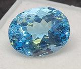 8.97cts oval cut Blue Topaz gemstone with gem ID card