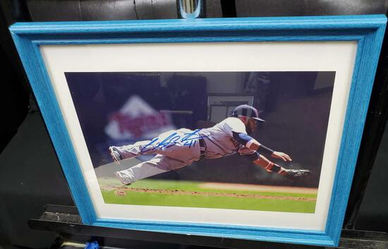 Framed and signed picture of Carlos Santana with certificate of authenticity.