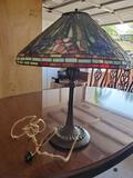 Tiffany style shade on vintage brass lamp.