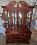Two piece china cabinet with lighting and glass Shelving