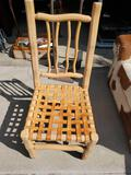 Unique wooden chair with leather straps seat