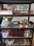 Lot of puzzles. Encyclopedias. Lightbulbs. Rugs. Baskets. Other misc.