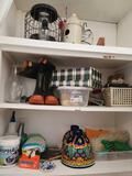 Contents of fixed cabinet w Bird feeders Mexican wall planters odds and ends