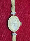 Longines 14k gold and diamond watch