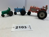 Three plastic Auburn tractors (Red No. 572)
