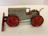 Metal Wind Up Tractor With Blade. Driver Is Missing