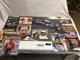 Collectible lot of Dale Earnhardt magazine and posters. Includes inside magazine NASCAR 1:64 scale