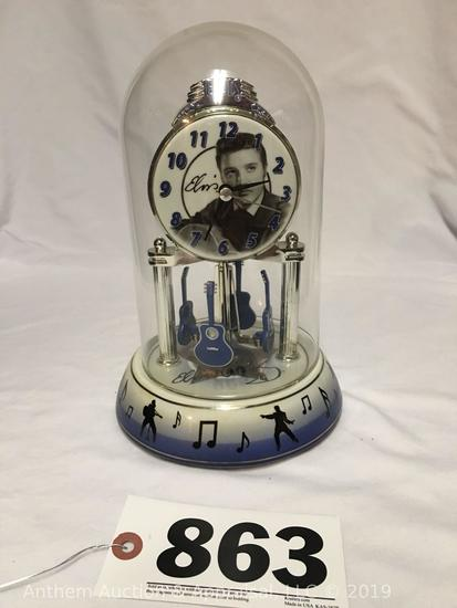 Elvis Presley glass dome tabletop clock with guitar mobile and printed signature.