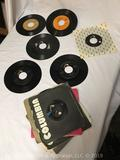 Elvis Presley lot of 45 RPM singles including Blue Suede Shoes, Don't Be Cruel, and many others