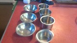 7 misc small Stainless steel bowls