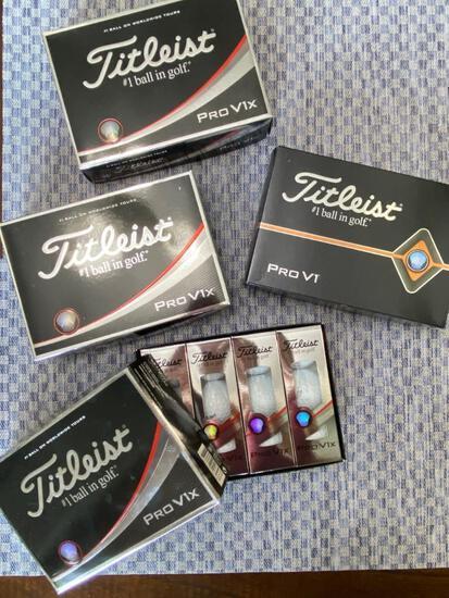 Titleist Pro V1X (3 boxes) and Pro V1 (1 box) golf balls.