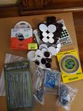 Misc bundle of cushion felt pads small eye bolts and wire for hanging things. Needle file set and