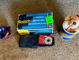 Camera, Cup, Scotch Labeling Tape, and More