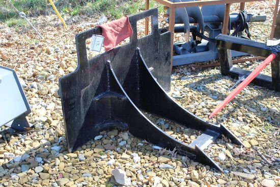 Skid loader root and stump Plucker