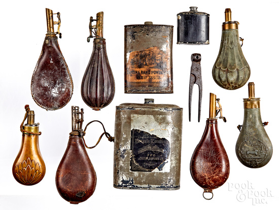 Group of powder flasks and tins