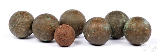 Six bronze cannon balls, etc.