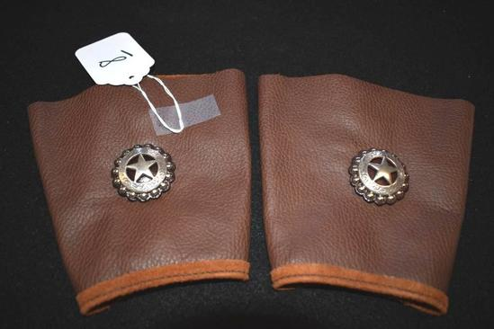 Pair of Arm Cuffs with Silvered Concho on each