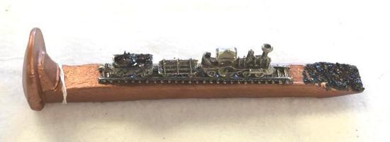 Copper Color Railroad Tie with Train Tracks and coal
