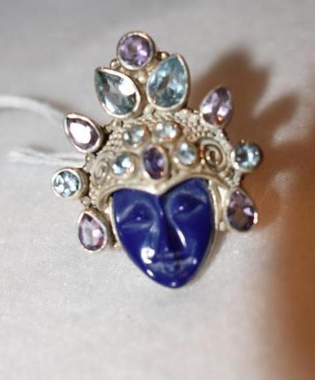 Sterling Ring Aztec style face of carved purple stone and blue topaz and amethyst gems