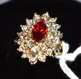 Ladies cocktail ring with red center stone and white accents surrounding, Costume jewelry