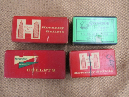 mixed bullets lot. 3 partial boxes of 7mm approx 200+. one box 32 special approx 50+
