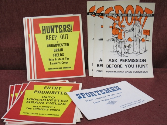 lot of vintage hunting posters and signs.