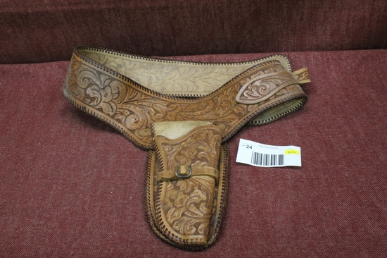 Elaborate leather holster and belt.