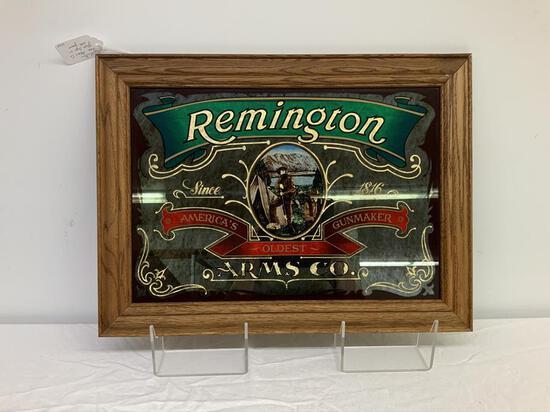 Remington advertising glass sign framed in an oak frame,