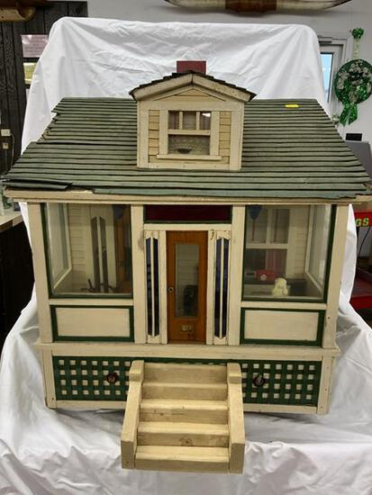 vintage child's model cottage with some interior
