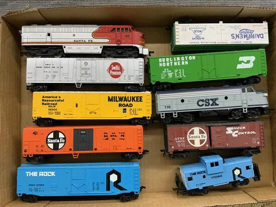 10 piece HO scale trains. 2 engines, 8 cars & caboose