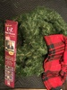 4 pine wreaths, bow maker in box and red plaid table cloth