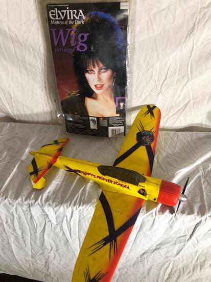 Elvira Wig And Toy Airplane