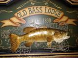 Old bass lodge framed in Barnwood