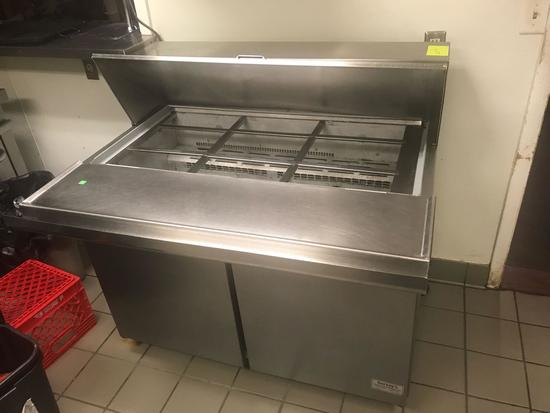 McCall Stainless steel prep table with coffin type top. Under counter refrigeration