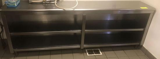 Stainless steel work surface with under counter storage.
