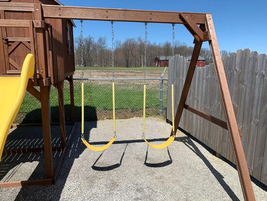 Wooden frame swing set with play house