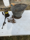 Cutting torch, traps, coal bucket